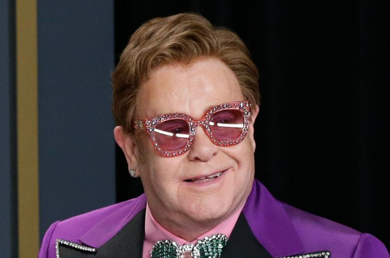Elton John has walking pneumonia, cuts concert short