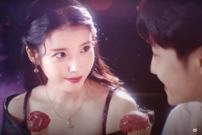 Watch: IU goes on magical date in 'Strawberry Moon' video